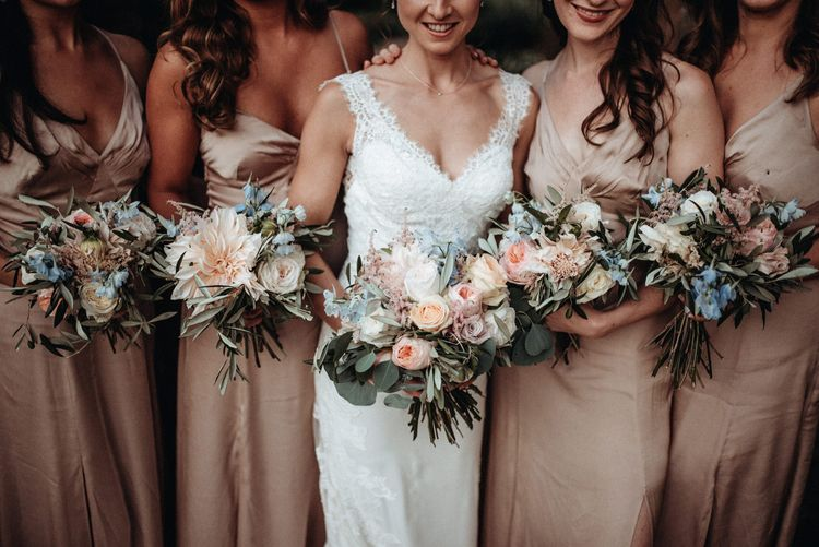 Pastel Bridal Party Bouquets | Bride in Lace Pronovias Wedding Dress | Bridesmaids in Pink Debenhams Dresses | Classic Country Wedding at Wadhurst Castle, East Sussex with Wedding Suppliers from RMW. The List | Foto Memories Photography