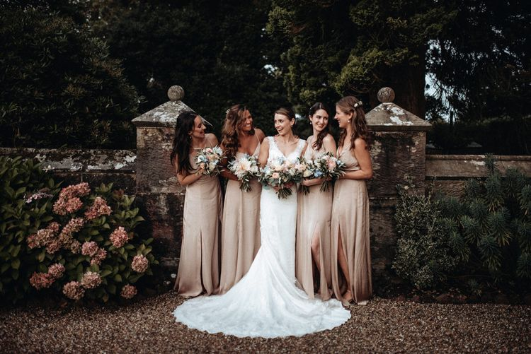 Bridal Party | Bridesmaids in Pink Debenhams Dresses | Bride in Lace Pronovias Wedding Dress | Classic Country Wedding at Wadhurst Castle, East Sussex with Wedding Suppliers from RMW. The List | Foto Memories Photography