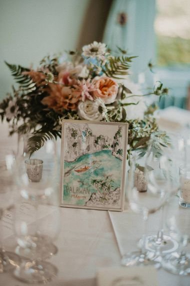 Daisy Ellen Pastel Floral Arrangement & Wildflower Illustration Co. Table Name Centrepiece | Classic Country Wedding at Wadhurst Castle, East Sussex with Wedding Suppliers from RMW. The List | Foto Memories Photography
