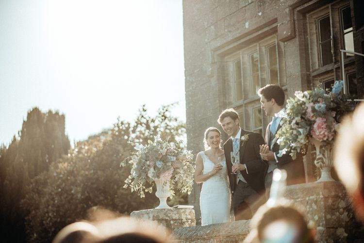 Outdoor Speeches | Bride in Lace Pronovias Wedding Dress | Groom in Traditional Morning Suit by Macinnes Bespoke Tailoring | Classic Country Wedding at Wadhurst Castle, East Sussex with Wedding Suppliers from RMW. The List | Foto Memories Photography