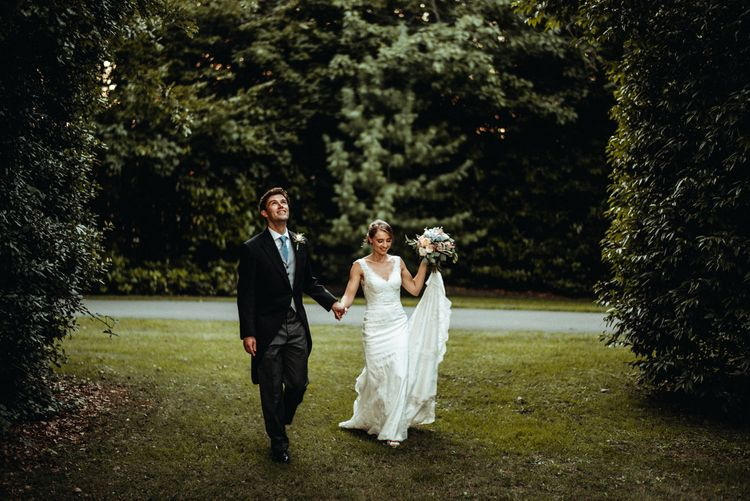 Bride in Lace Pronovias Wedding Dress | Groom in Traditional Morning Suit by Macinnes Bespoke Tailoring | Classic Country Wedding at Wadhurst Castle, East Sussex with Wedding Suppliers from RMW. The List | Foto Memories Photography