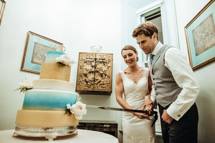 Cutting the Wedding Cake | Bride in Lace Pronovias Wedding Dress | Groom in Traditional Morning Suit by Macinnes Bespoke Tailoring | Classic Country Wedding at Wadhurst Castle, East Sussex with Wedding Suppliers from RMW. The List | Foto Memories Photography
