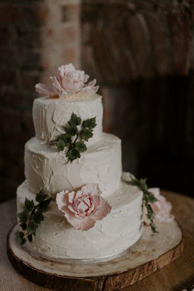Homemade Wedding Cake on Log Slice Cake Stand