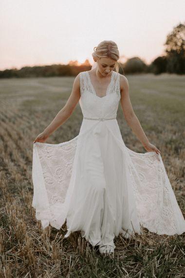 Bride in Charlie Brear Carenne Wedding Dress with Corette Lace Overdress and Emmy London Belt