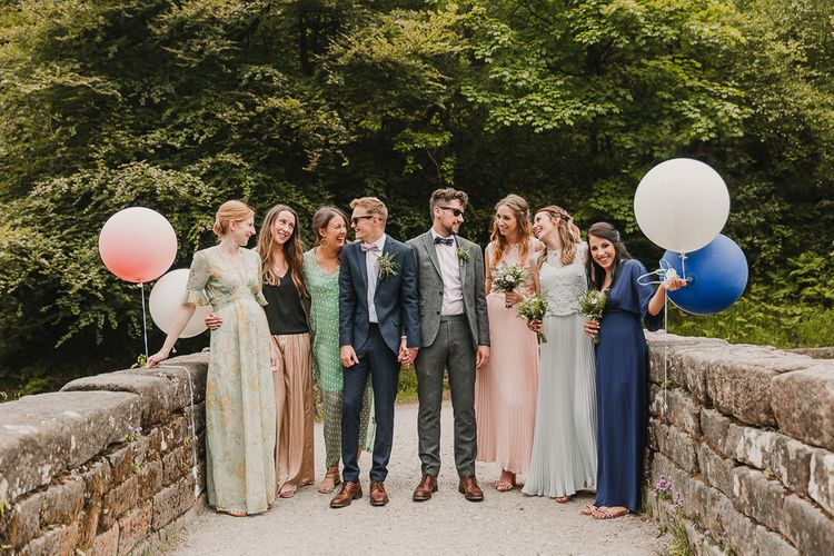 Wedding Party With Balloons / Foliage And Plant Filled Industrial Wedding At Gibson Mill And The Arches Dean Clough Yorkshire With Images From Lianne Gray Photography