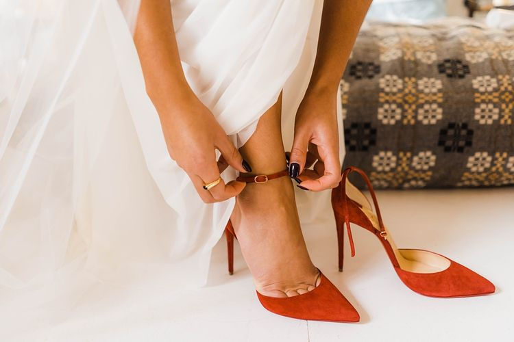 Red Christian Louboutin Shoes | Laced KatyaKatya Wedding Dress with Cap Sleeves and Ribbon Belt | Lace KatyaKatya Dress for Tipi Wedding at Fforest Farm | Claudia Rose Carter Photography