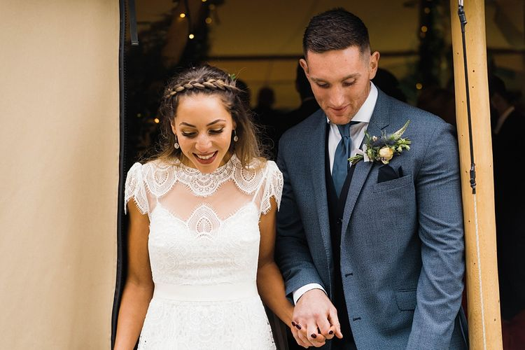Just Married | Bride in Laced KatyaKatya Wedding Dress with Cap Sleeves and Ribbon Belt | Groom in Blue T.M Lewin Suit with Navy Hawkes Bespoke Outfitters Waistcoat | Lace KatyaKatya Dress for Tipi Wedding at Fforest Farm | Claudia Rose Carter Photography