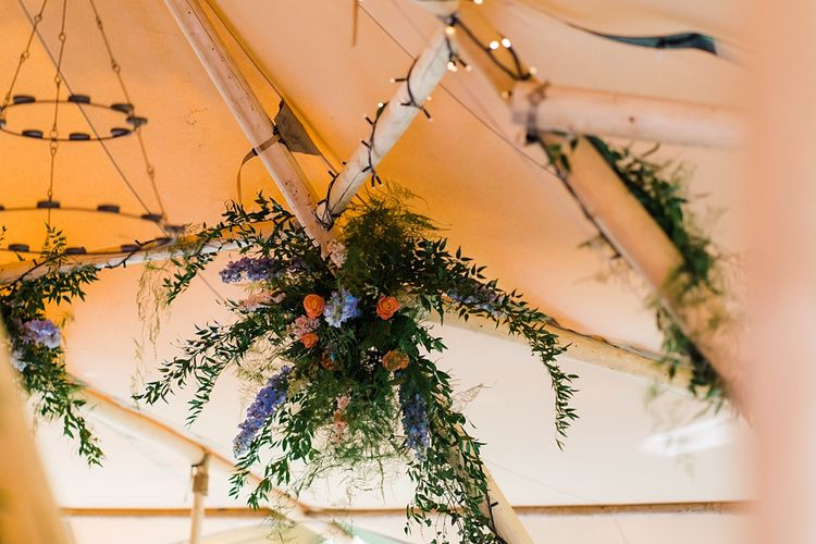 Wedding Reception Decor | Hanging Floral Installation in Tipi | Lace KatyaKatya Dress for Tipi Wedding at Fforest Farm | Claudia Rose Carter Photography