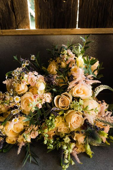 Bridesmaids Bouquets of Mixed Wild Flowers with Daisys, Lavender and White Roses | Lace KatyaKatya Dress for Tipi Wedding at Fforest Farm | Claudia Rose Carter Photography
