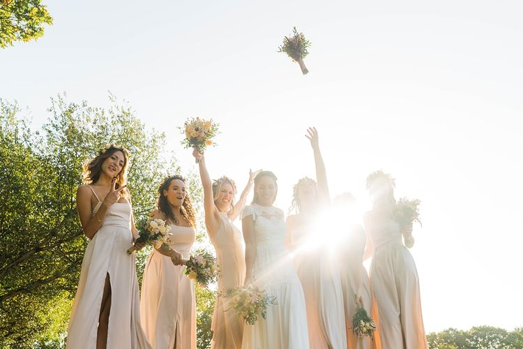 Bride in Laced KatyaKatya Wedding Dress with Cap Sleeves and Ribbon Belt | Bridesmaids in Dusty Pink ASOS Dresses | Flower Crowns | Mixed Wild Flower Bouquets with Daisys, Lavender and White Roses | Lace KatyaKatya Dress for Tipi Wedding at Fforest Farm | Claudia Rose Carter Photography