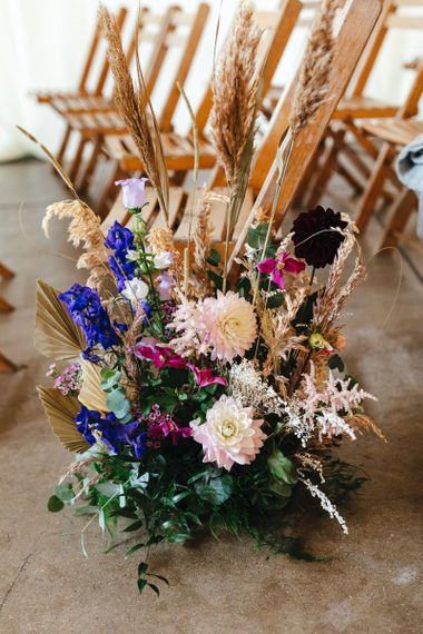 Vibrant floral aisle decor at dry hire wedding venue in London