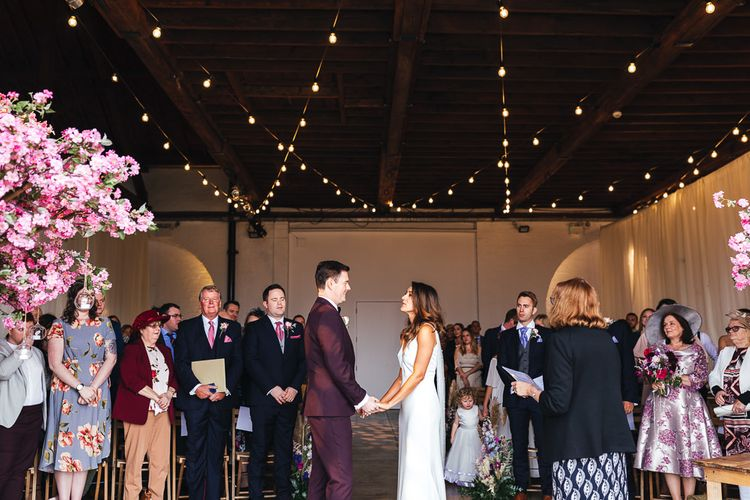 Dry hire wedding venue with festoon lighting and pink blossom trees