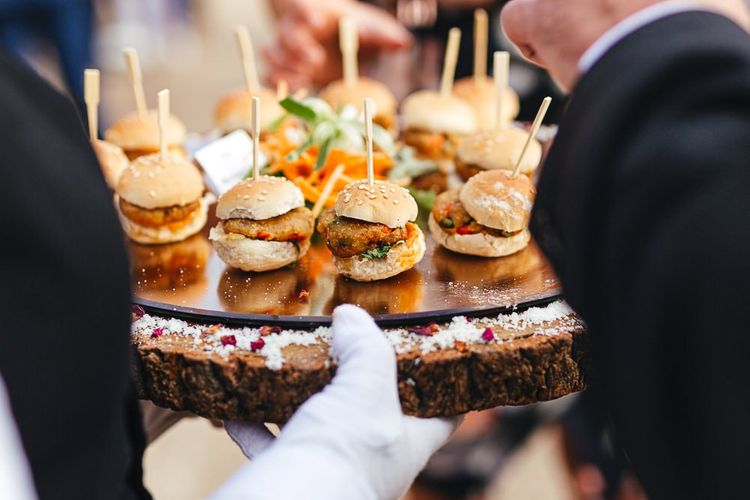 Canapes are served at London reception