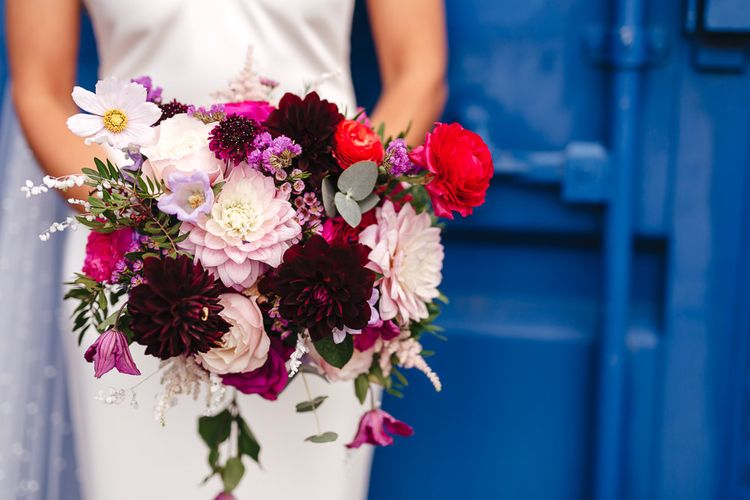 Beautiful vibrant bridal bouquet with pinks and purples