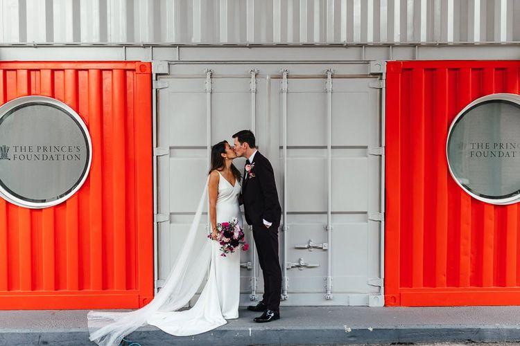 Bride and groom embrace at London celebration