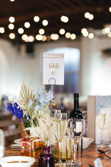 Table numbers and floral table arrangements at dry hire wedding venue
