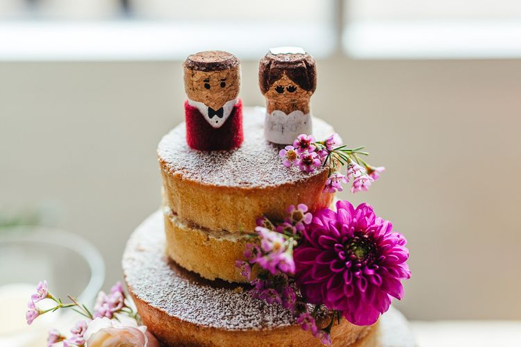 Bride & Groom cork cake toppers with vibrant floral decoration