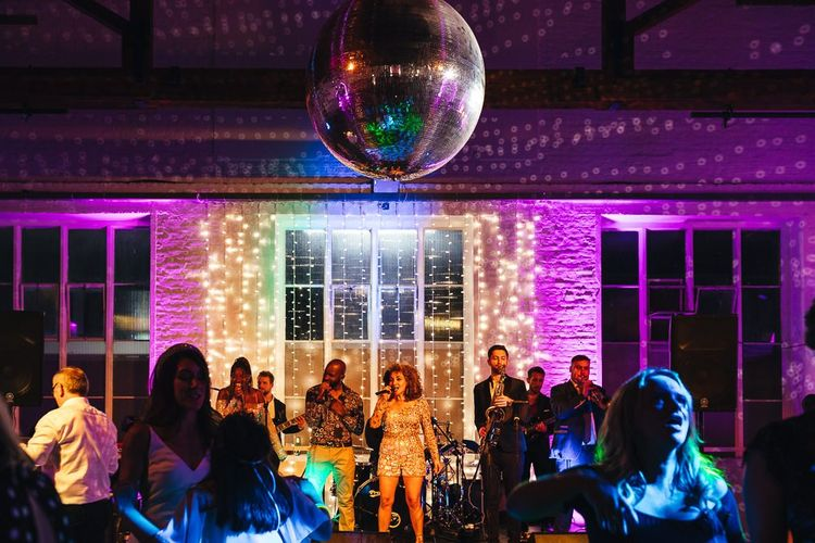 Entertainment at dry hire wedding venue with glitter ball
