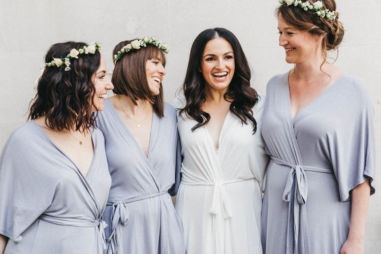 Wedding Morning Preparations at The Ned | Bride in White Getting Ready Robe | Bridesmaids in Blue Getting Ready Robes | Stunning Syon Park Wedding with Quill Stationery Suite | Nancy Ebert Photography