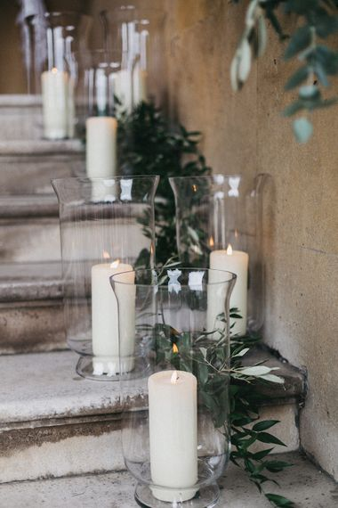 Step Decor at Syon Park | Hurricance Vases and Pillar Candles | Eucalyptus | Stunning Syon Park Wedding with Quill Stationery Suite | Nancy Ebert Photography