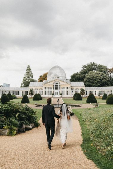The Great Conservatory at Syon Park | Bride in Hermione de Paula Wedding Gown with Short Sleeves and Personalised Embroidery | Cathedral Veil | Groom in Navy Lanvin Tuxedo and Black Burberry Shoes | Burgundy Bow Tie | Blush, Cream and Pink Bridal Bouquet | Stunning Syon Park Wedding with Quill Stationery Suite | Nancy Ebert Photography