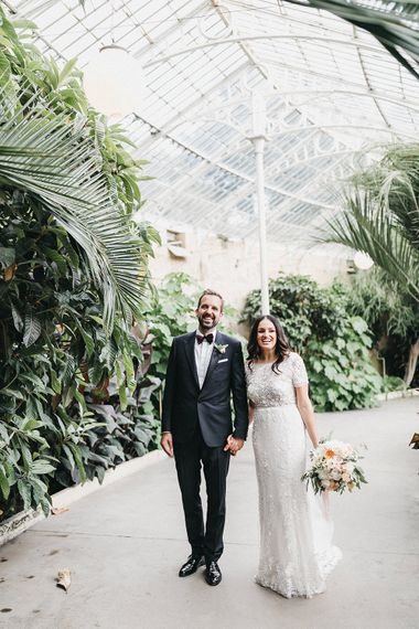 Bride in Hermione de Paula Wedding Gown with Short Sleeves and Personalised Embroidery | Cathedral Veil | Groom in Navy Lanvin Tuxedo and Black Burberry Shoes | Burgundy Bow Tie | Blush, Cream and Pink Bridal Bouquet | Stunning Syon Park Wedding with Quill Stationery Suite | Nancy Ebert Photography