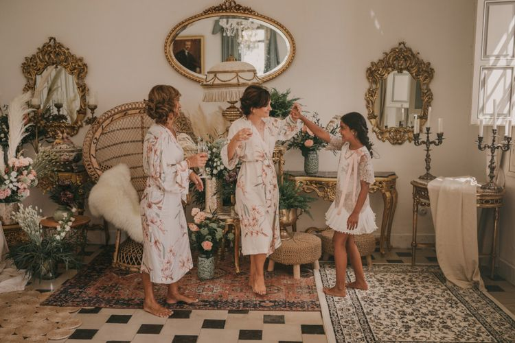 Wedding Morning Bridal Preparations with Bridesmaids in Floral Getting Ready Robes