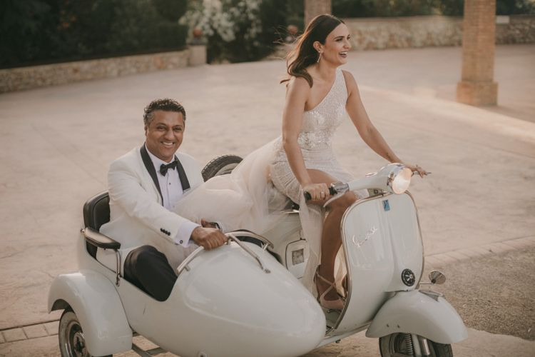 Stylish Bride and Groom Riding a Vespa on a Side Car