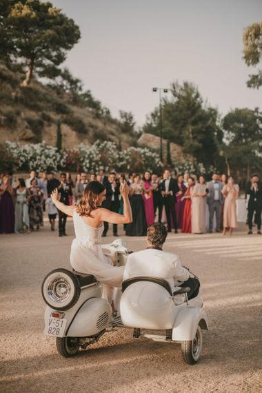 Bride and Groom Riding in a Vespa and Side Car