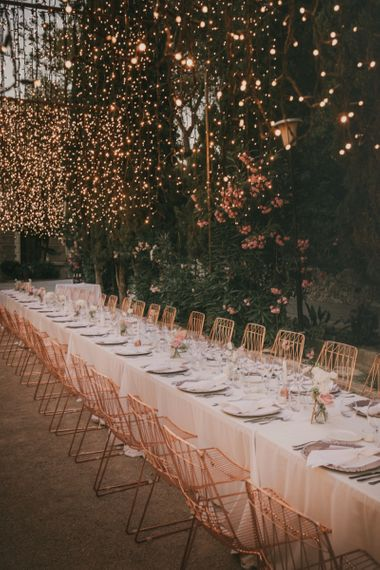 Long Trestle Wedding Breakfast Table with Fairy Light Canopy and Copper Chairs