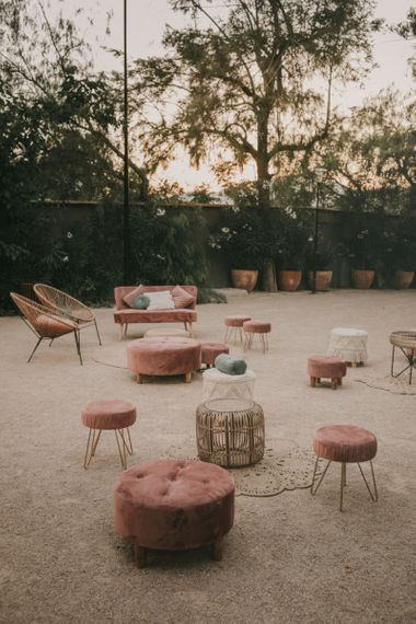 Chill Out Area with Blush Velvet Love Seats and Poufs and Wicker Chairs