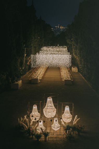 Outdoor Wedding Reception with Fairy Light Canopy and Chandelier Feature Table Plan at Marqués de Montemolar in Spain