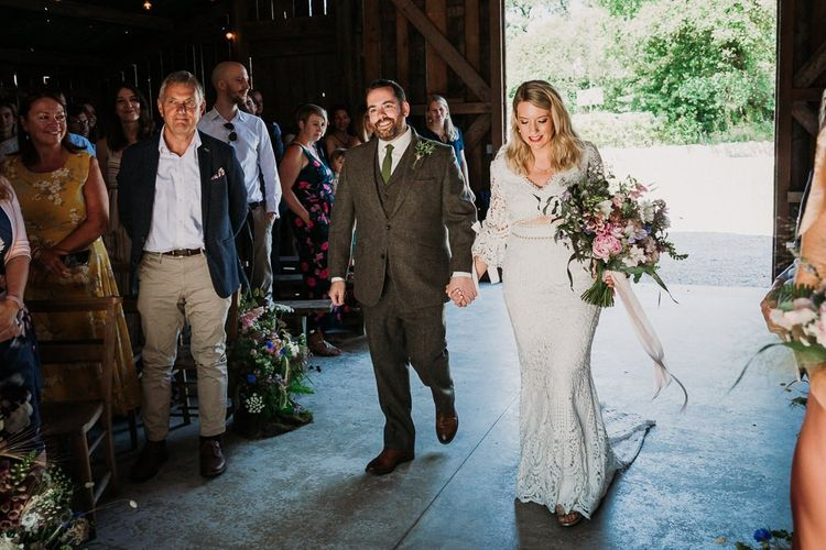 Bride and Groom Walk Up The Aisle Together
