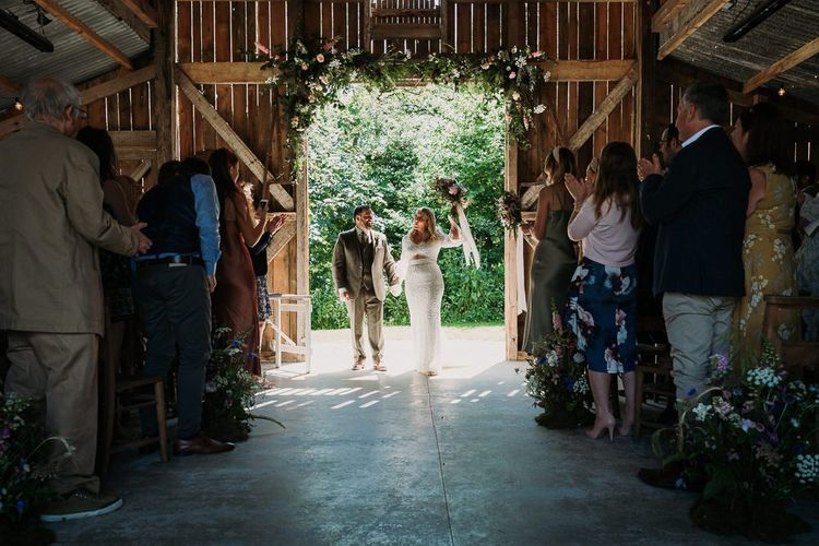 Bride and Groom During Rustic Barn Ceremony