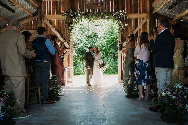 Bride and Groom During Rustic  Ceremony