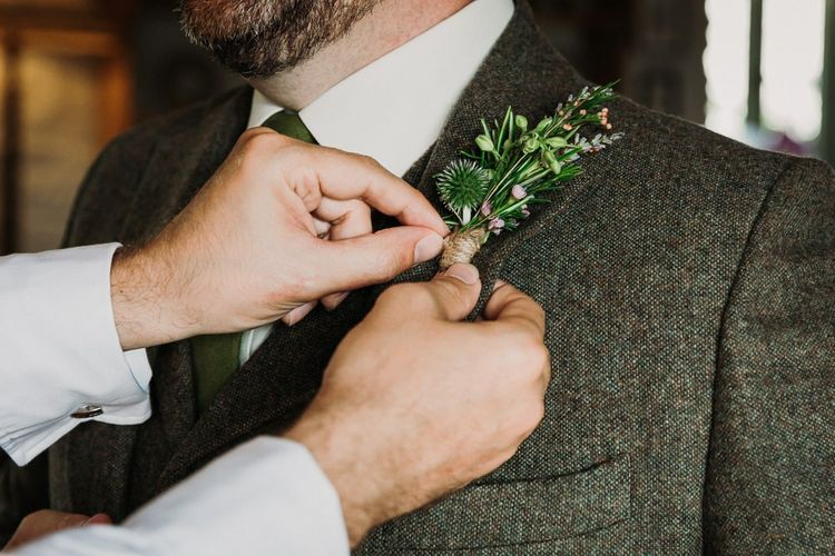 Groom Fitting His Buttonhole