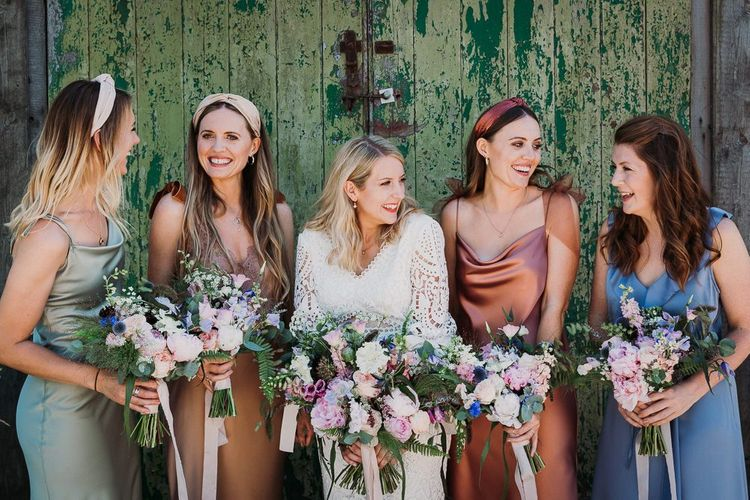 Bride and Bridesmaids in Mismatched Bridesmaid Dresses