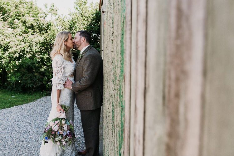 Bride and Groom with Wedding Bouquet and Tweed Suit