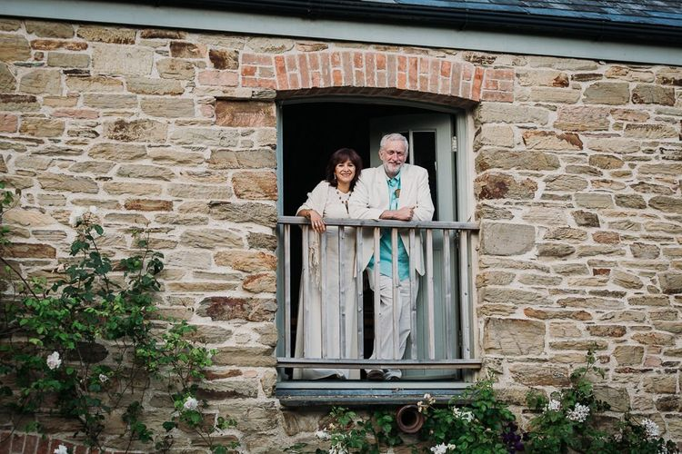 Wedding Guests Look Out of Barn During Wedding