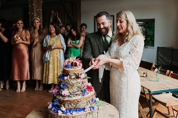 Bride and Groom Cut the Naked Wedding Cake