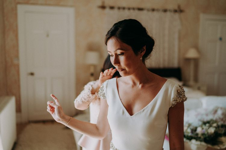 Bride in Pronovias wedding dress with jewel cap sleeves