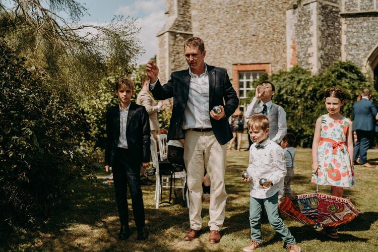 wedding guests playing bowls at Butley Priory humanist wedding