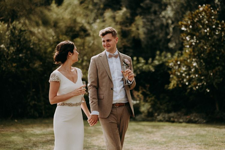 Bride and groom at elegant English country garden wedding