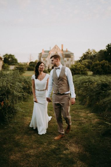 Bride in Pronovias wedding dress and groom in beige waistcoat