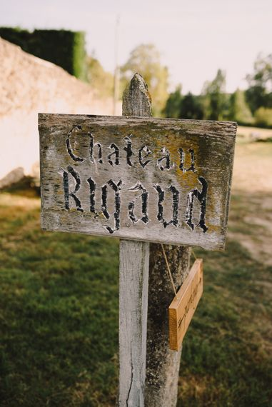 Wooden Wedding Venue Sign | Sophisticated Outdoor Wedding at Chateau Riguad, France with Neutral Colour Palette | Modern Vintage Weddings Photography