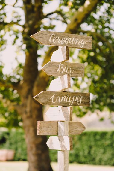 Wooden Direction Wedding Sign | Sophisticated Outdoor Wedding at Chateau Riguad, France with Neutral Colour Palette | Modern Vintage Weddings Photography