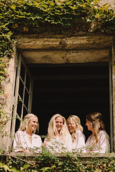 Bridal Party Matching Robes | Wedding Morning Bridal Preparations | Sophisticated Outdoor Wedding at Chateau Riguad, France with Neutral Colour Palette | Modern Vintage Weddings Photography