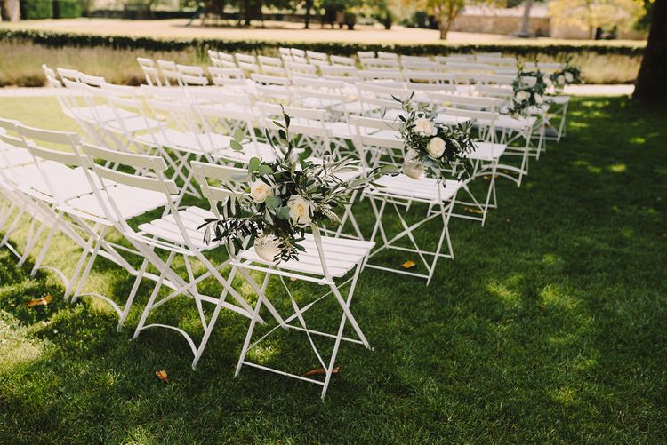 White & Greenery Floral Aisle Chair Wedding Decor | Sophisticated Outdoor Wedding at Chateau Riguad, France with Neutral Colour Palette | Modern Vintage Weddings Photography