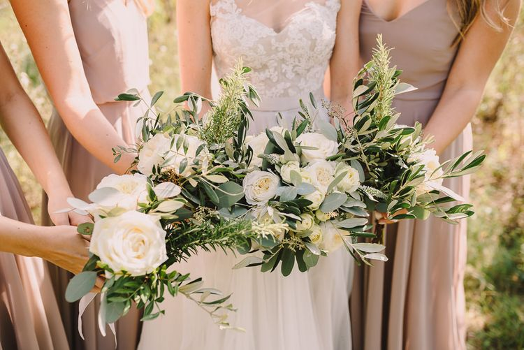 Bridal Party White Flower Bouquets | Bridesmaids Nude in Jenny You Dresses  | Bride in Watters Gown | Sophisticated Outdoor Wedding at Chateau Riguad, France with Neutral Colour Palette | Modern Vintage Weddings Photography