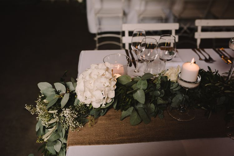 Greenery & White Hydrangea Floral Garland Table Runner | Sophisticated Outdoor Wedding at Chateau Riguad, France with Neutral Colour Palette | Modern Vintage Weddings Photography